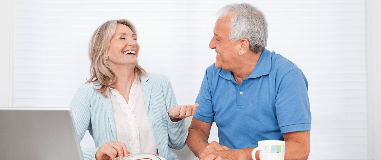 downsizing-after-retirement-things-to-consider-couple-laughing.png