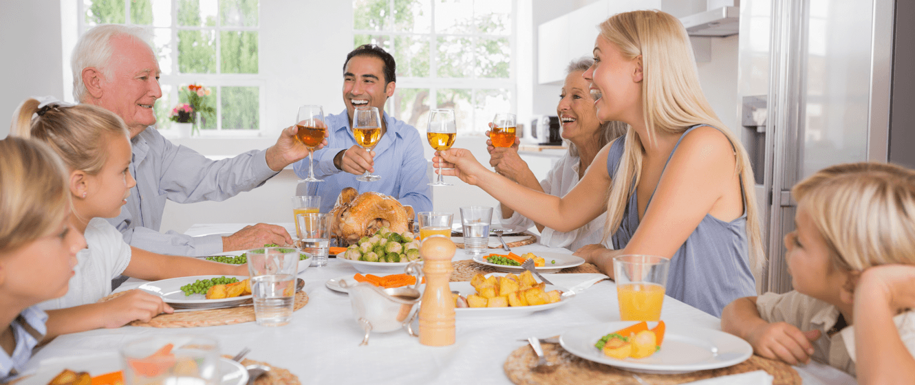 tips-hosting-thanksgiving-in-condo-family-eating-featured-image.png