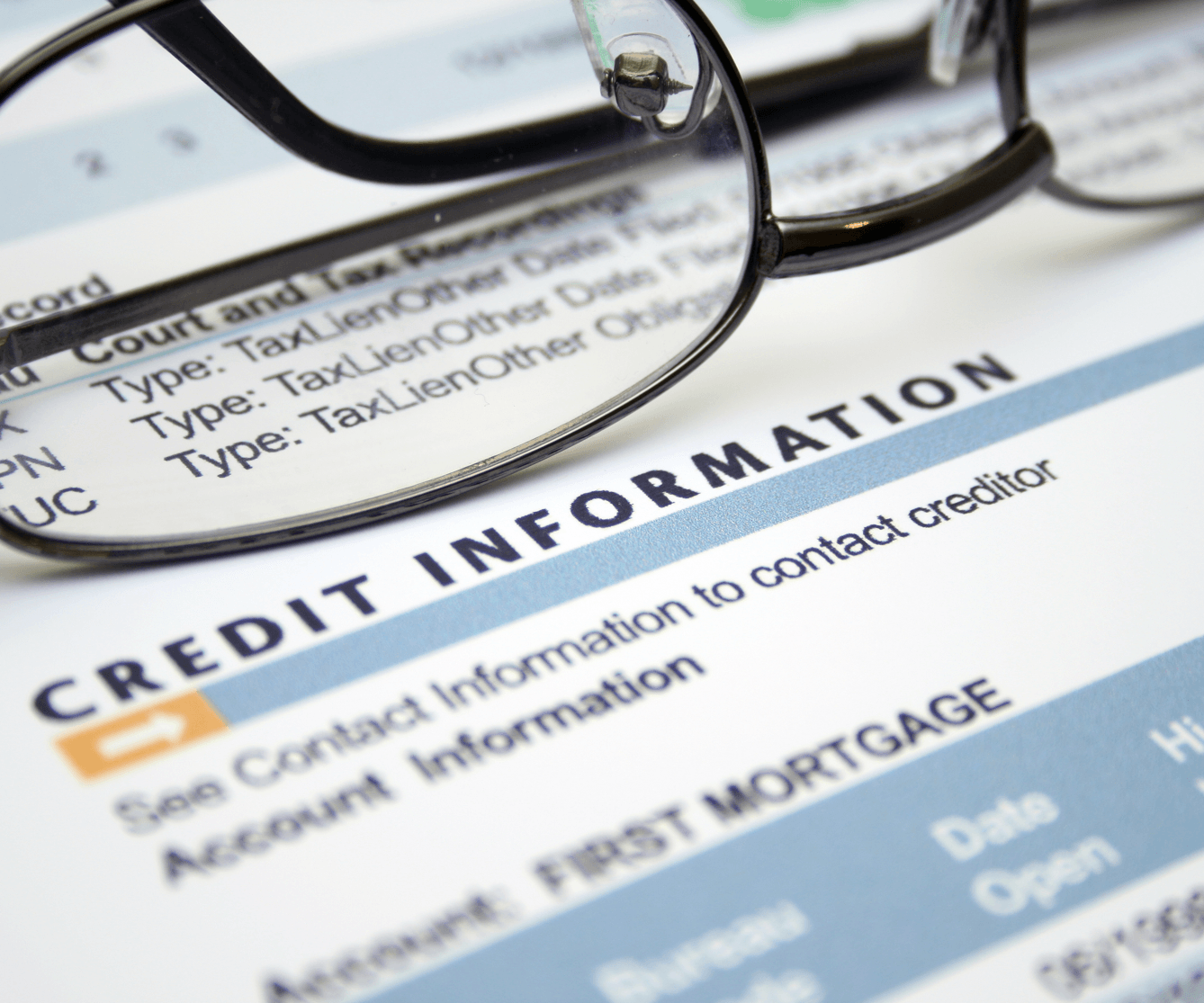 How Credit Scores Affect Mortgage Rates Paperwork Image
