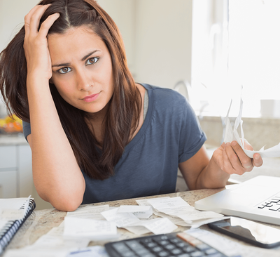 Top Tips for Paying Bills Off Faster Frustrated Woman Image